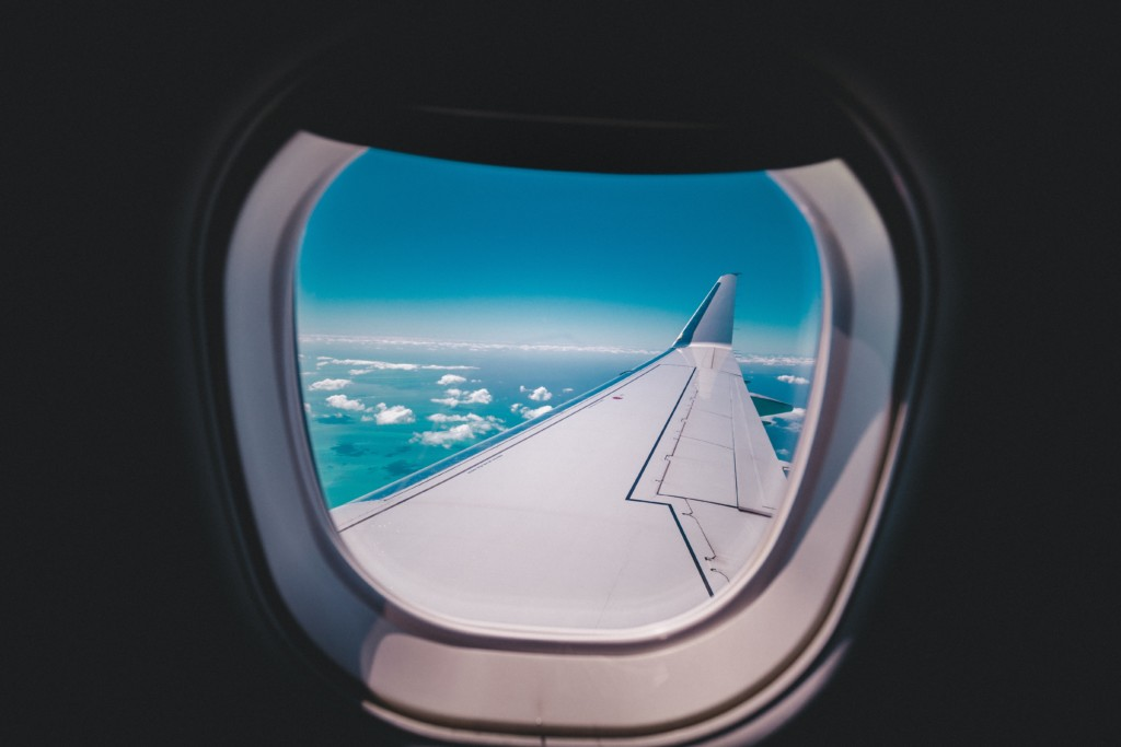 airplane window Traveling with Kids: Tips from One Mom to Another Vanessa Santamaria Contributor Miami Moms Blog