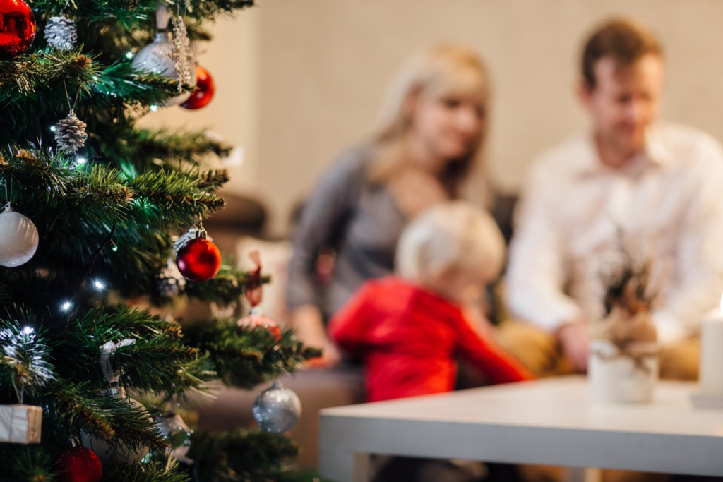 playing by christmas tree Accepting the Invitation to Play with our Kids this Holiday Season Bethany Pappas Contributor Miami Moms Blog