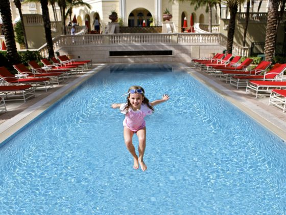 Girl-Jumping-Into-Pool 5 Unexpected Family-Friendly Luxury Hotels in Miami Ann Ueno Contributor Miami Moms Blog