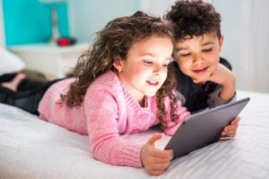 Two Cute brother and sister enjoying tablet at home Comcast Xfinity: Helping Families Safely Enjoy the Internet Valerie Barbosa Contributor Miami Moms Blog
