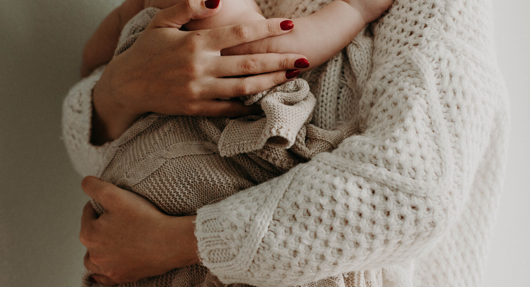 A mother holding her baby in her arms (Great Habits To Form When Handling Your Baby Andrea Wood Contributor Miami Mom Collective)