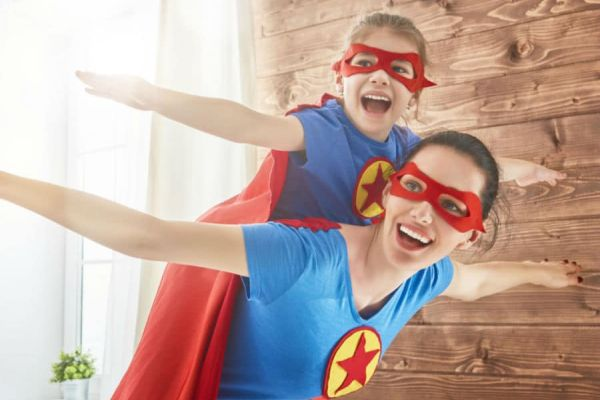 A mother and daughter in superhero costumes (Boosting the Immune System for a Great School Year Ahead Adita Lang Contributor Miami Mom Collective)