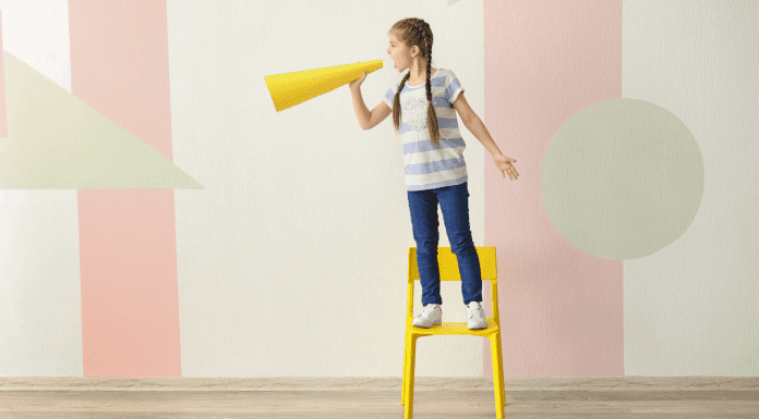 A young girl with a megaphone (Keeping Your Kid's Voice Healthy: Some Helpful Tips Cindy Herde Contributor Miami Mom Collective)