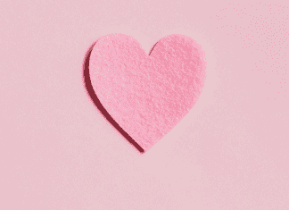 A pink paper heart (More Self-Love in 2021: 7 Ways to Love Ourselves Daily Rachelle Haime Contributor Miami Mom Collective)