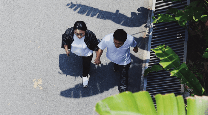 A couple holding hands and going for a walk (Creative Date Night Ideas on a Budget Becky Gonzalez Contributor Miami Mom Collective)