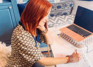 Dacia working at her desk (Steps for Creating Vision and Clarity for the New Year Dacia Wiegandt Contributor Miami Mom Collective)