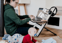 A mom working from home while watching her baby (Daycare & Preschool During the Ongoing Pandemic Bella Behar Contributor Miami Mom Collective)