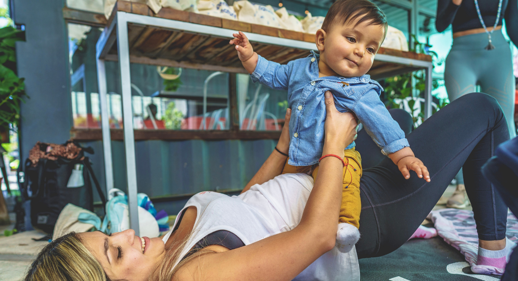 Bella exercising with her son (Baby Weight: How to Lose It Without Pressure Bella Behar Contributor Miami Mom Collective)
