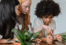 Girls working with plants (International Day of Women and Girls in Science Zoe Costa Contributor Miami Mom Collective)