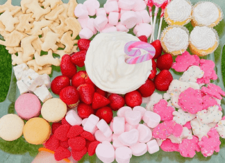 A Valentine's Day themed snack try with animal crackers, marshmallows, macarons, strawberries, and cupcakes (Valentine's Day: Fun, Family-Friendly Ideas Becky Salgado Contributor Miami Mom Collective)