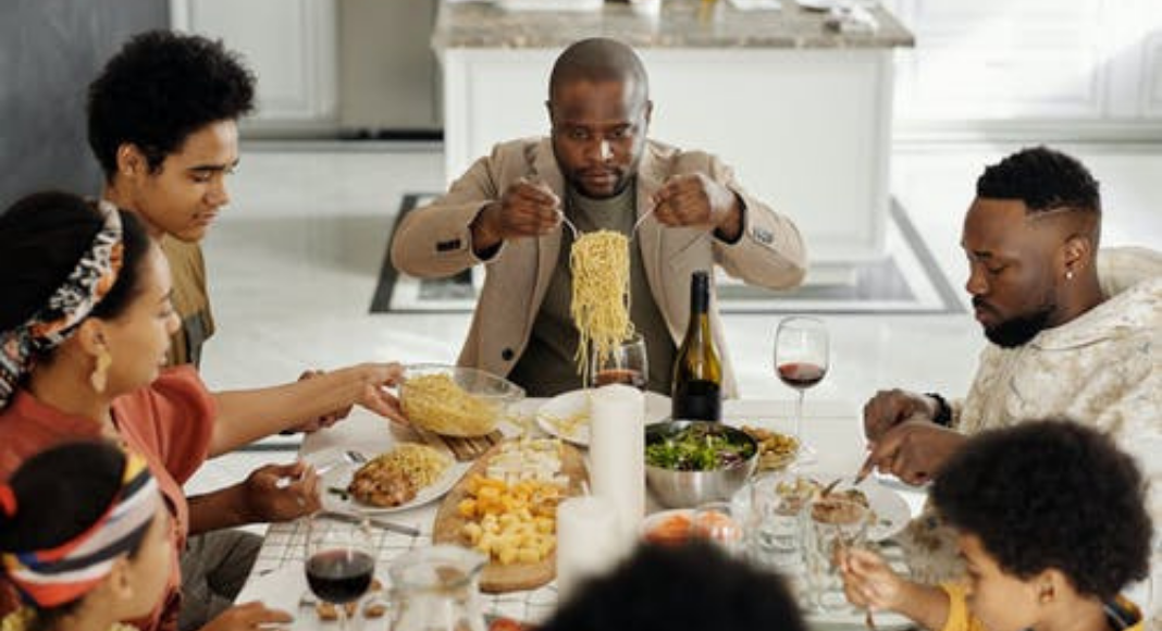 Family eating spaghetti (Family Mealtime is the Heart of the Home Holly Farver Contributor Miami Mom Collective)