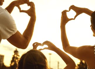 A family making hearts with their hands (Love Where You Live: Why I Love Living in Hialeah Lorena Lougedo Contributor Miami Mom Collective)