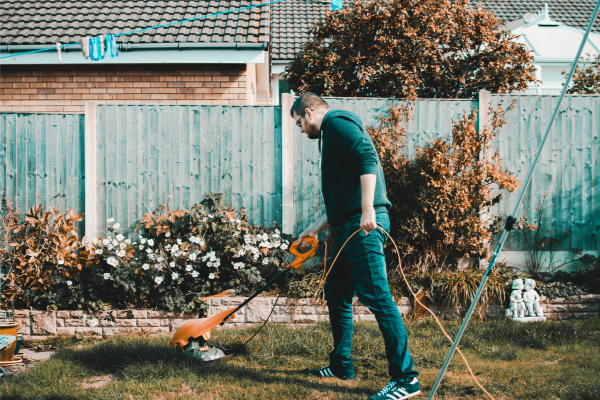 A man doing yard work (Lorena Lougedo Contributor Miami Mom Collective)