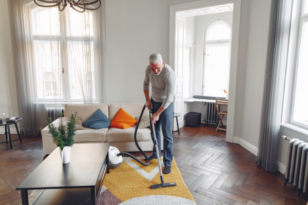 A man vacuuming (Husband Appreciation Day: Celebrate the Hubbies Lorena Lougedo Contributor Miami Mom Collective)