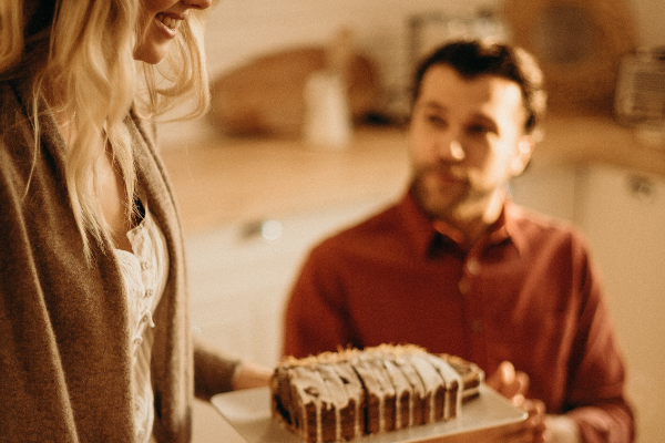 A couple celebrating with cake (Husband Appreciation Day: Celebrate the Hubbies Lorena Lougedo Contributor Miami Mom Collective)