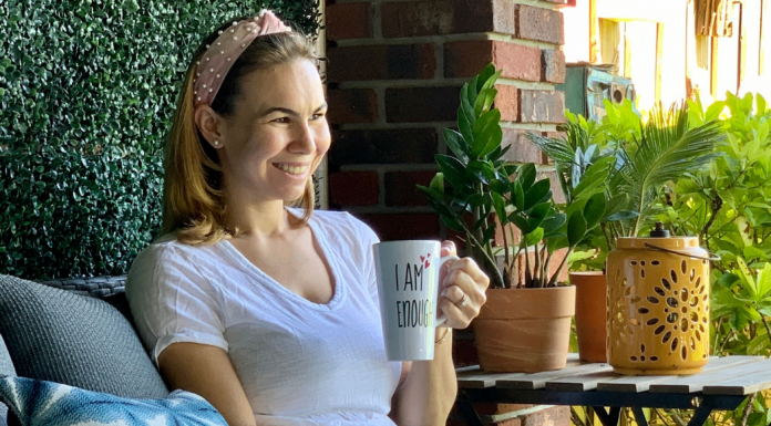 Jessica sitting with a cup of coffee (Miami Mom Collective Welcomes MIA Mom Jessica Socarras Contributor)