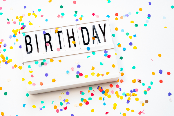 A festive birthday sign (Let's Celebrate: National Reading Across America Day Lorena Lougedo Contributor Miami Mom Collective)