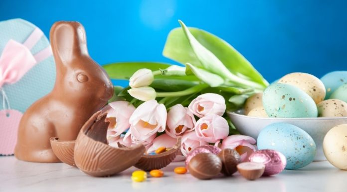 A chocolate Easter bunny with tulips and chocolate eggs (Celebrating Easter With A Creative Egg Hunt Jessica Alvarez-Ducos Contributor Miami Mom Collective)