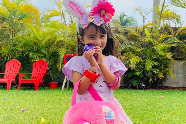 My daughter with a basket of eggs (Celebrating Easter With A Creative Egg Hunt Jessica Alvarez-Ducos Contributor Miami Mom Collective)
