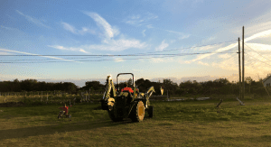 Kristina's husband on a tractor (Making Changes: Taking A Step Back In Order To Move Forward Kristina Fiorentino Contributor Miami Mom Collective)