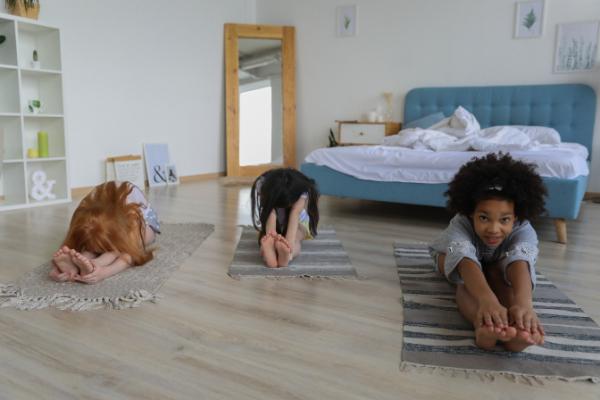 Kids doing yoga together (Jessica Alvarez-Ducos Contributor Miami Mom Collective)