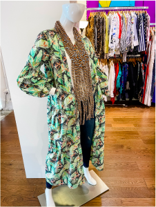 A mannequin displaying a duster and necklace (Meredith Kallaher Contributor Miami Mom Collective)