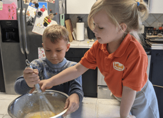 Rachel's kids stirring waffle batter (International Waffle Day: Like Music to My Ears Rachel Hulsund Contributor Miami Mom Collective)