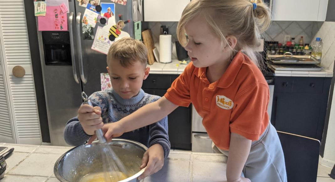 Rachel's kids stirring waffle batter (International Waffle Day: Like Music to My Ears Rachel Hulsund Contributor Miami Mom Collective)