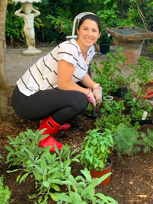 Aymee in her garden (Florida Garden: Start Yours During National Gardening Month Aymee Blanco Contributor Miami Mom Collective)