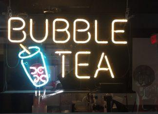 A neon sign that says bubble tea (Bubble Tea: My Epic Quest for the Perfect Boba Combination Kristen Llorca Contributor Miami Mom Collective)