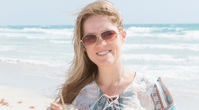 Dina enjoying the beach (Miami Mom Collective Welcomes MIA Mom Dina Garcia Contributor)