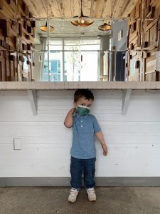 Brittany's son at Panther Coffee (Love Where You Live: Why I Love Living in the Upper East Side Brittany Aquart Contributor Miami Mom Collective)