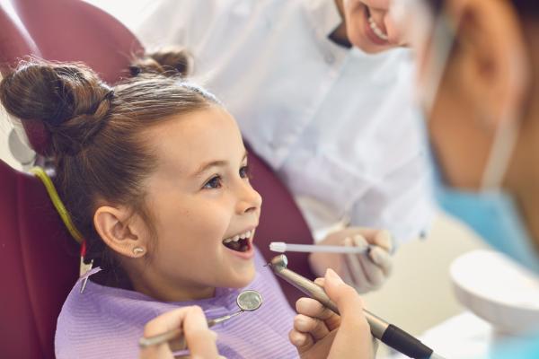 A little girl at the dentist (Toothbrushing Power Struggles: 3 Tips & Tricks | Dr. Bob Pediatric Dentist Lynda Lantz Contributor Miami Mom Collective)