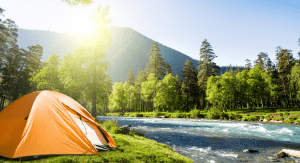 Tent camping in the mountains (Let's Go Places! 5 Trips to Take Now Vanessa Santamaria Contributor Miami Mom Collective)