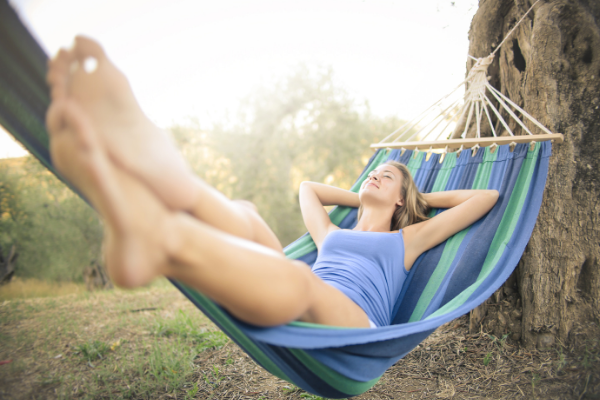 A woman lounging in a hammock (Fighting Summer Boredom Lorena Lougedo Contributor Miami Mom Collective)