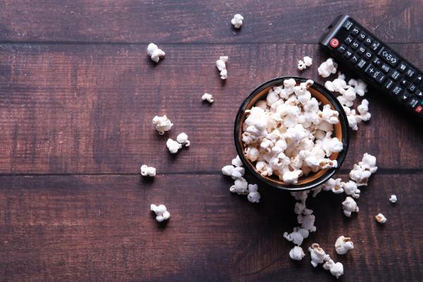 A bowl of popcorn and a remote control (Fighting Summer Boredom Lorena Lougedo Contributor Miami Mom Collective)