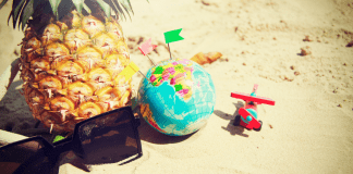 Sunglasses, a pineapple, a toy airplane, and a globe (Fighting Summer Boredom Lorena Lougedo Contributor Miami Mom Collective)