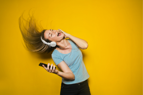 A woman listening to music (Lorena Lougedo Contributor Miami Mom Collective)