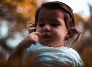 A little toddler girl (Toothbrushing Power Struggles: 3 Tips & Tricks | Dr. Bob Pediatric Dentist Lynda Lantz Contributor Miami Mom Collective)