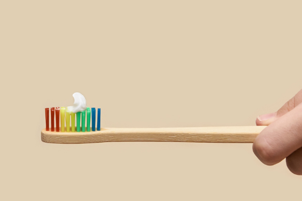 A colorful toothbrush with a pea-sized amount of tooth paste (Toothbrushing Power Struggles: 3 Tips & Tricks | Dr. Bob Pediatric Dentist Lynda Lantz Contributor Miami Mom Collective)