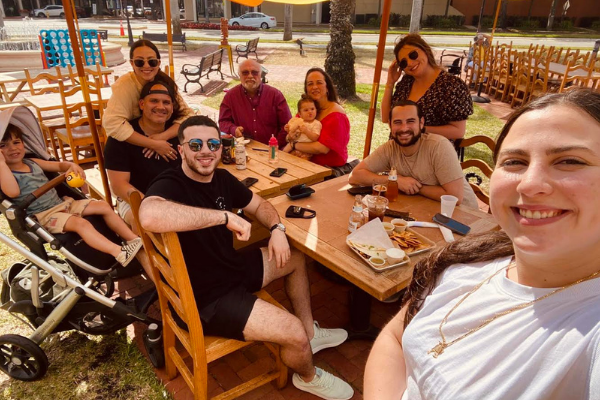 Jacqueline and her friends at a local outdoor restaurant (Jacqueline Jebian Garcia Contributor Miami Mom Collective)