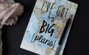 A map of the world and a pen (Summer Road Trips: Adventure Awaits You This Summer Jessica Alvarez-Ducos Contributor Miami Mom Collective)