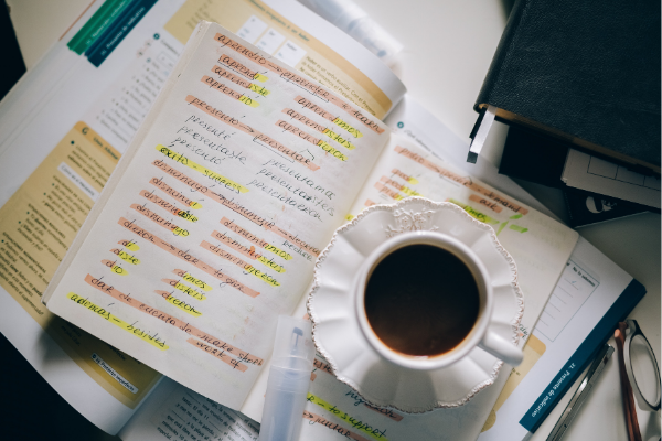 A cup of tea and an open journal (Zoe Costa Contributor Miami Mom Collective)