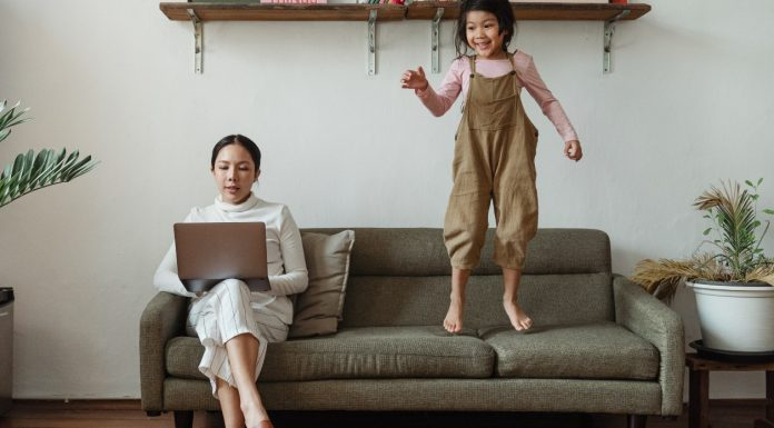 """A mom working from home while her daughter plays (5 Steps to Supporting Your """"Single Mom"""" Friends Kristen Llorca Contributor Miami Mom Collective)"""