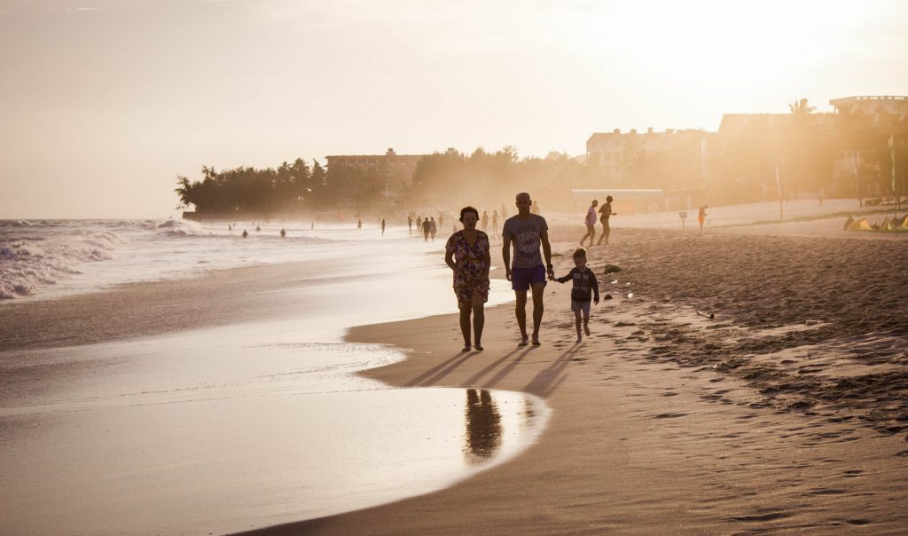 A family walking on the beach (Janeris Marte Contributor Miami Mom Collective)