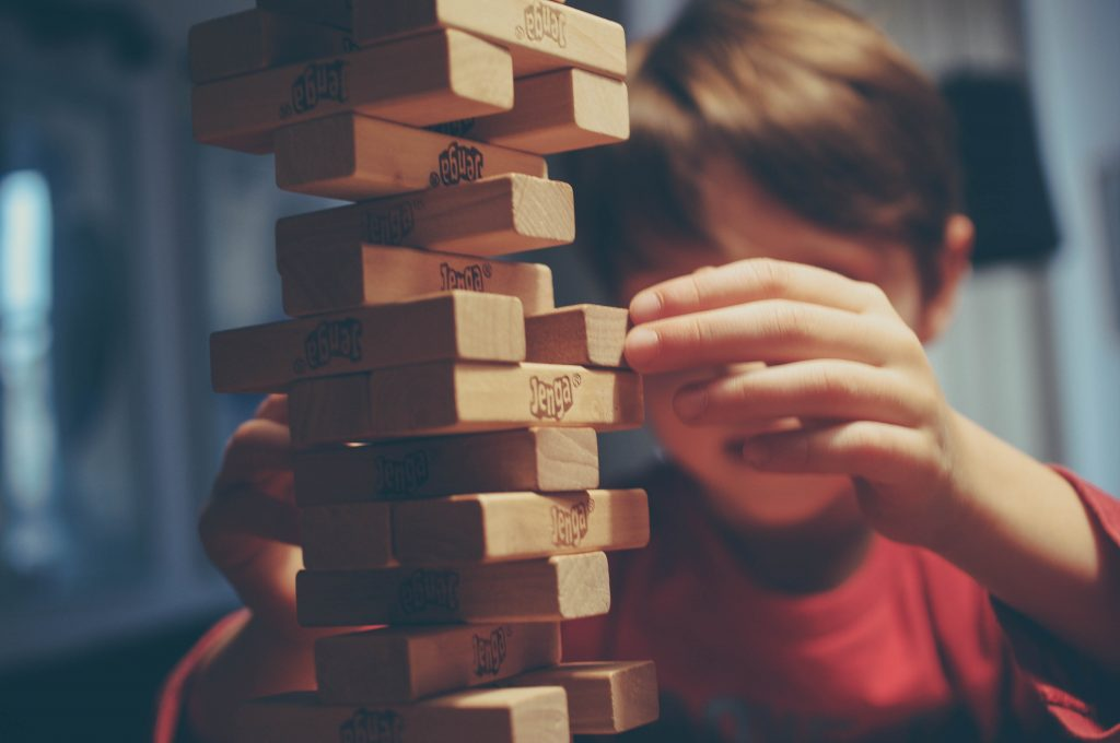 A kid playing Jenga (Fun Without Your Phone (Except to Take Amazing Photos and Videos) Janeris Marte Contributor Miami Mom Collective)