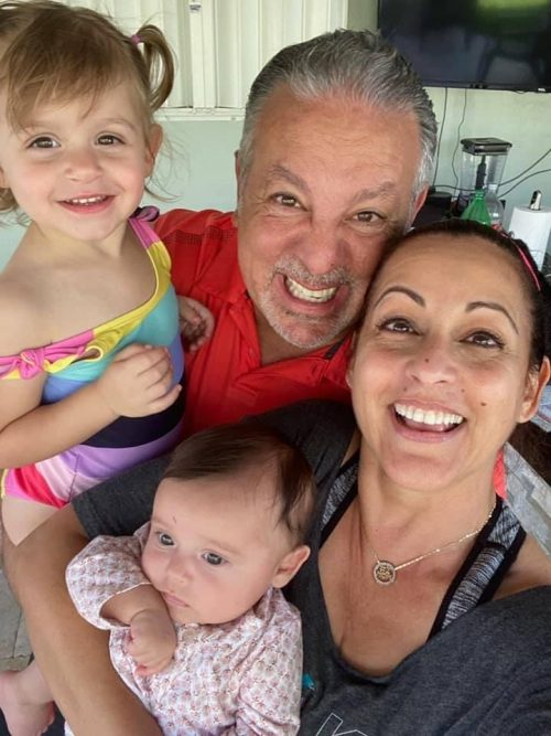Alina with her husband and grandchildren (Wisdom and Reflections on Motherhood by 3 Generations of Miami Moms Alisa Britton Contributor Miami Mom Collective)