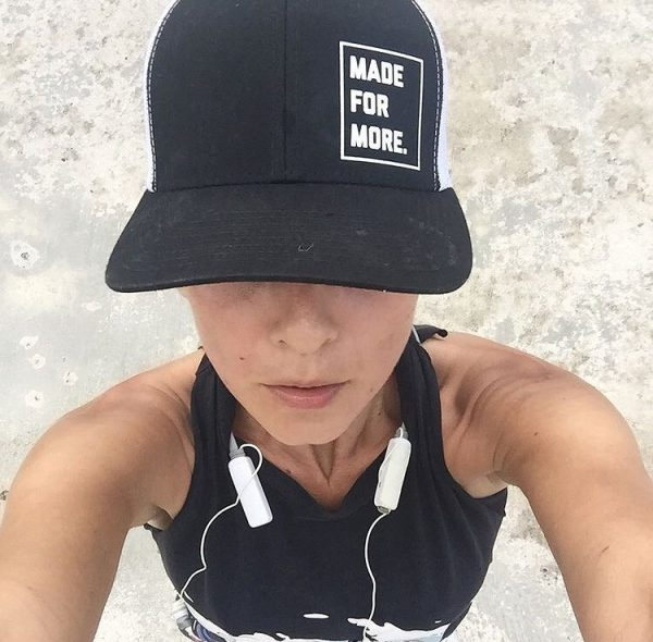 """A female runner wearing a hat that says """"Made for More"""" (Run Like A Mother: A Beginner's Guide to Running Kristen Llorca Contributor Miami Mom Collective)"""