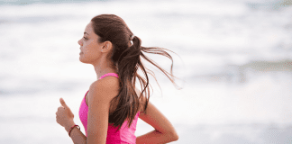 A woman running (Run Like A Mother: A Beginner's Guide to Running Kristen Llorca Contributor Miami Mom Collective)