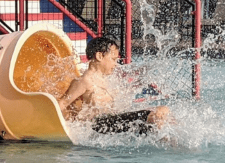Going down a water slide (Summer Is Almost Here! Are You Ready? | Dr. Bob Pediatric Dentist Lynda Lantz Contributor Miami Mom Collective)
